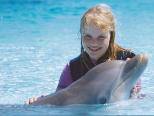 Sarah swims with Dolphins